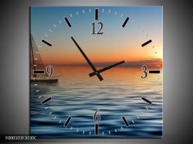 Wandklok op Canvas Zonsondergang | Kleur: Blauw, Geel, Oranje | F000103C