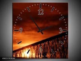 Wandklok op Canvas Zonsondergang | Kleur: Oranje, Zwart, Wit | F001177C